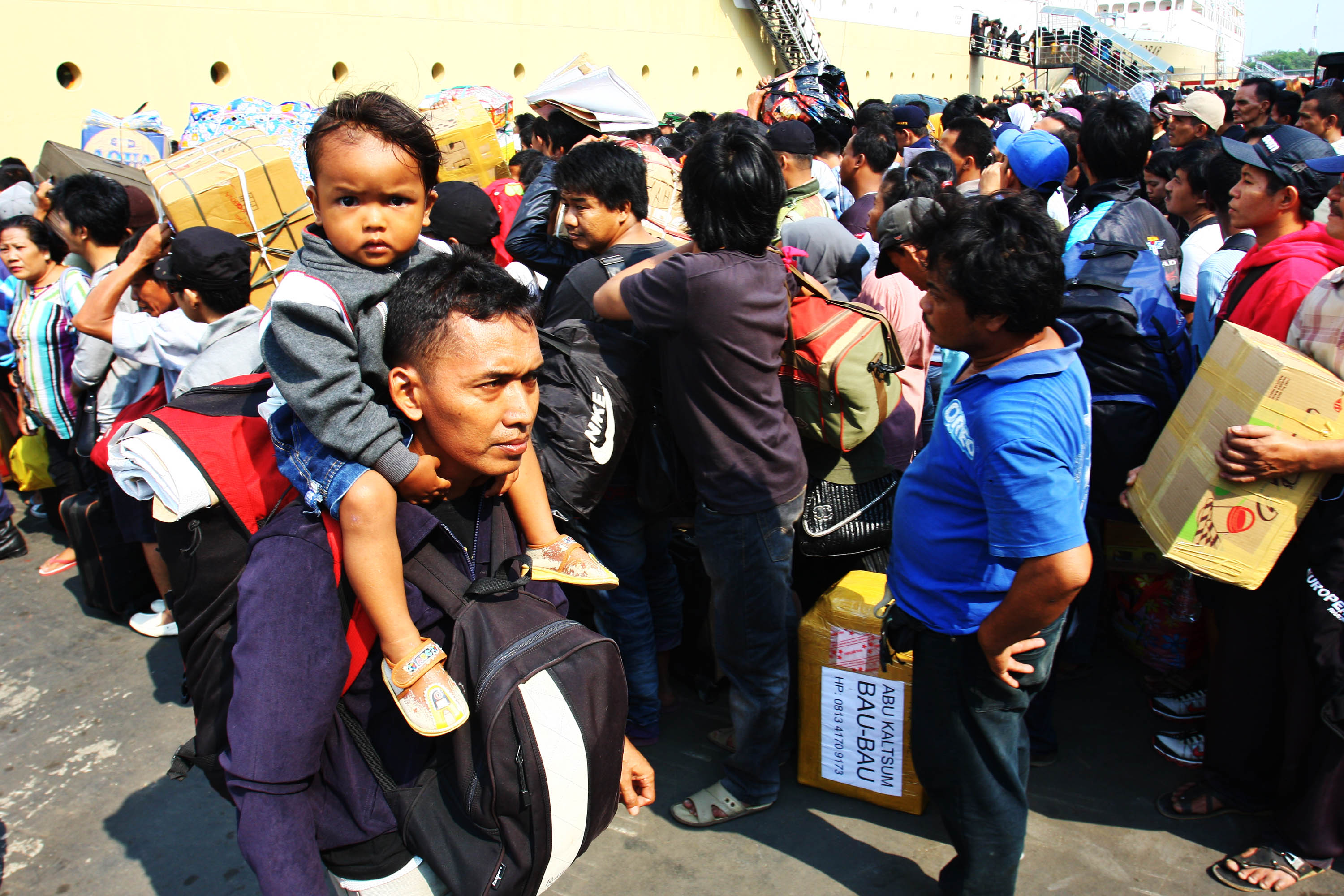 Thousands of people queueing at Tanjung Priok harbor, Jakarta, By: Iwan- Denaya Images