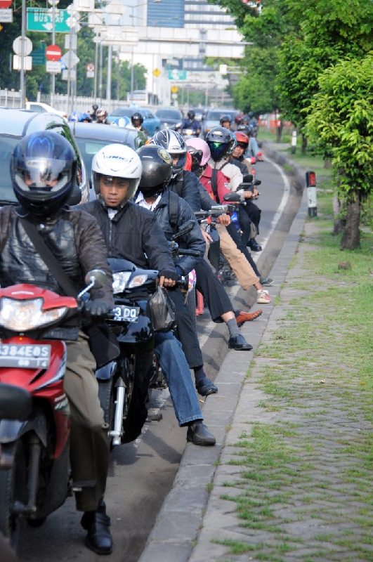 Motorcyclists at the traffic lights (Sudirman area, Jakarta) Yekaterina Gaisenok