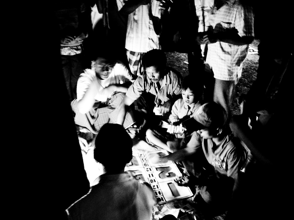 Children and adults gambling on Bali, By: Rolan Budi