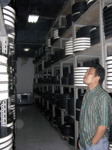 Hartono, head of film maintenance division, in the storage room