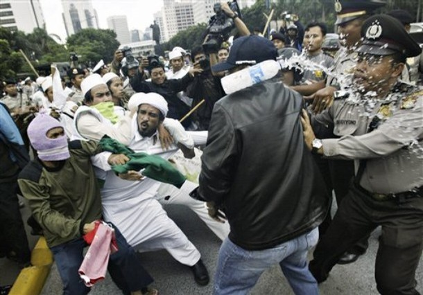 Inside the islam defender front interview with an fpi chief latitudes fpi demonstrators scuffle with police in jakarta in 2007 tatan syuflana reheart Gallery
