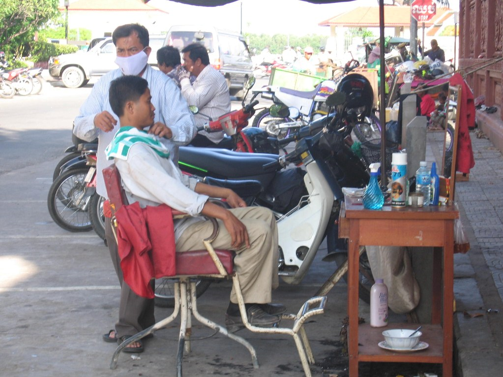 Getting a haircut in Phnom Penh, By: Willem van Gent