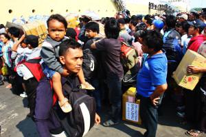 Thousands of people queueing at Tanjung Priok harbor, Jakarta, By: Iwan- Denaya Images