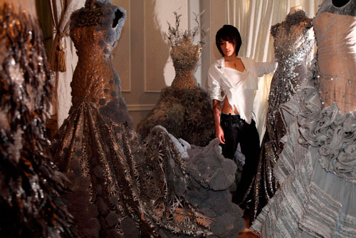 Tex Saverio between his dresses
