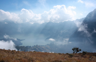 From afar, the crater of Rinjani looks beautiful and unspoiled, By: Angela Richardson
