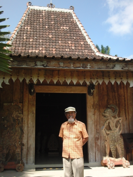 Prayitno in front of a Javanese 'joglo' house at the Setia Darma house of masks