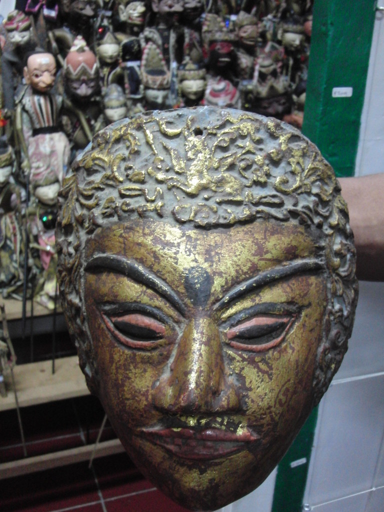 Antique mask from Madura with an ornamental flying horse