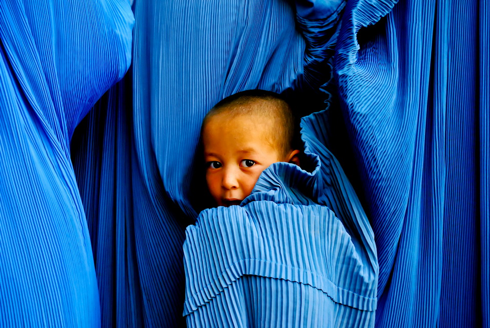 Boy in burqa, By: Agustinus Wibowo
