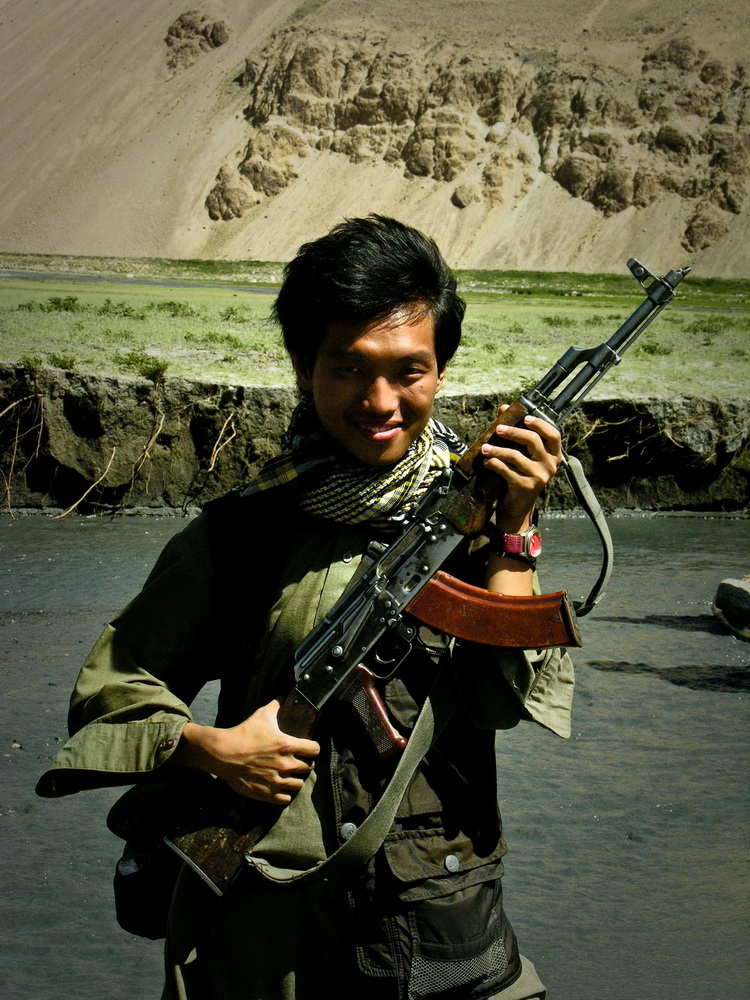Agustinus with an ak-47 at the Wakhan Corridor, Afghanistan, By: Agustinus Wibowo