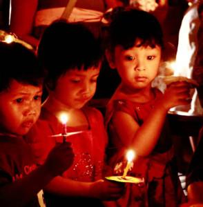 Children burning candles, By: Robertus B. Herdiyanto