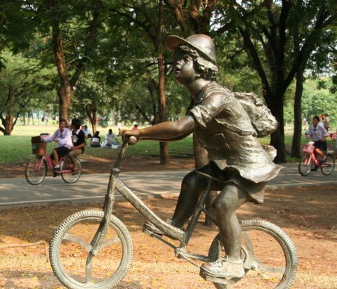 Child cyclist statue at Rot Fai Park, By: Isaac Olson