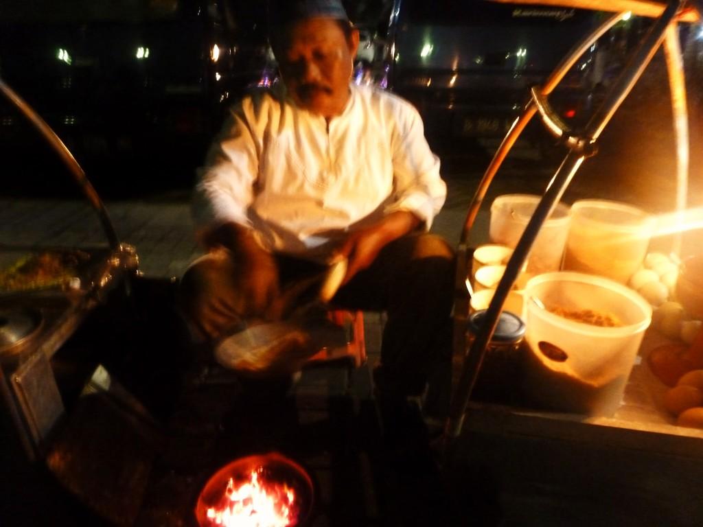Mr. Teguh (50), who has been selling Kerak Telor at Monas in Jakarta for 30 years, By: Rani Yunus
