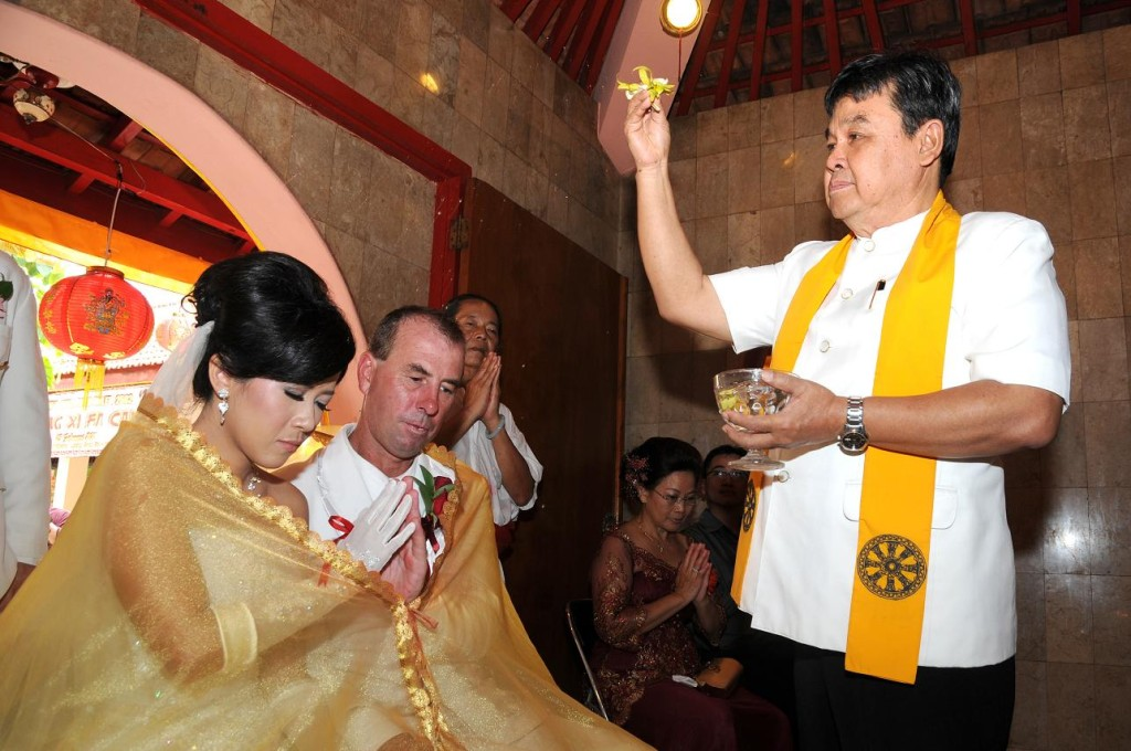 Buddhist blessing at Vihara Dharmayana, Kuta, Bali. 12 February 2011