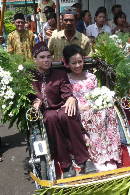 Nonie and Egbert take a becak ride at their wedding